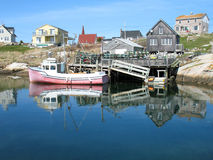 Peggys Cove. Cape Islander sitting at dock in small fishing village Stock Photo