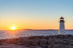 Peggys Cove Lighthouse at Sunset Stock Image