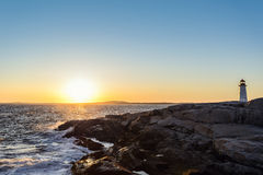 Peggys Cove Lighthouse at Sunset Stock Photography
