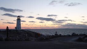 Peggys Cove Nova Scotia Sunset. Peggy`s Cove Lighthouse in Nova Scotia is one of the most iconic lighthouses in Canada. Capturing it at sunset is an absolute stock video footage