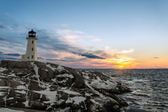 Peggys Cove's Lighthouse at Sunset Stock Images