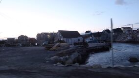 Peggys Cove Wharf. Driving thru Peggys Cove, Nova Scotia`s fishing village. The small fishing community is an iconic Eastern Canada sight to explore and see stock video footage