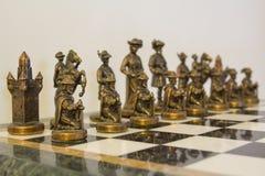 Pegni decorativi di scacchi: allineamento Immagini Stock