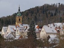 Pegnitz Church of St. Bartholomäus and observation tower. Church of St. Bartholomäus and observation tower in Pegnitz, Bavaria. Winter, houses covered with Royalty Free Stock Photography