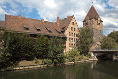 Pegnitz River, the bridge fault (Heybryuke) Tower debtors (Shuldturm). The historic center of the city. Nuremberg Royalty Free Stock Photo