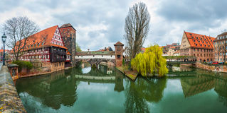 Pegnitz River in Nuremberg. Wine Store, Max Bridge, Hangman's Bridge over Pegnitz River in Nuremberg, Germany. Reflection in the water and cloudy sky Stock Photos