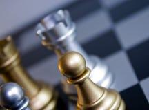 Pegno di scacchi dell'oro immagine stock libera da diritti