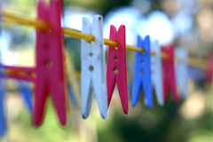 Pegs. On washing line Royalty Free Stock Image