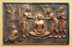 The pegs are being extracted with the help incers. Street bass relief on the wall of Jain Temple also called Parshwanath Temple in Kolkata, West Bengal, India Stock Photos
