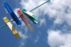 Pegs on clothes-line. Pegs hanging on clothes line royalty free stock photos