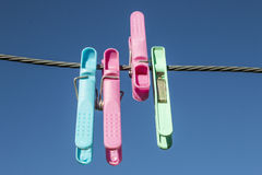 Pegs. On a clothes line Stock Photography