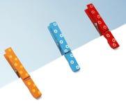 Pegs de madeira coloridos Imagens de Stock