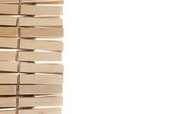 Pegs de madeira isolados no branco Imagem de Stock