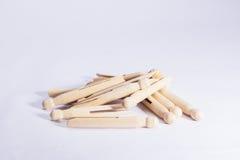 Pegs de roupa de madeira da zorra no fundo branco Imagem de Stock Royalty Free
