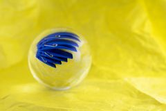 Pegs in a glass ball Stock Photo
