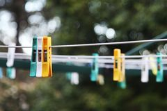 Pegs on a laundry line Stock Photos
