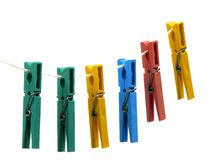Pegs on a line. Multi-coloured pegs pegged onto a piece of string Stock Photos