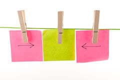 Pegs and paper sheets Stock Photo