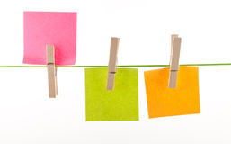 Pegs and paper sheets Royalty Free Stock Image