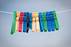 Pegs with sky in the background. Mollette, Pegs with sky in the background Stock Photography