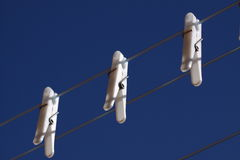 Pegs on washing line Stock Images