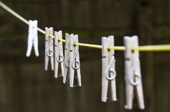 Pegs on washing line. Set of wooden pegs on washing line Stock Images
