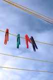 Pegs on a wet washing line. Assorted color pegs on a wet washing line Royalty Free Stock Photo