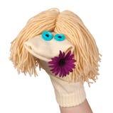 Pegue la marioneta con una flor Imagenes de archivo