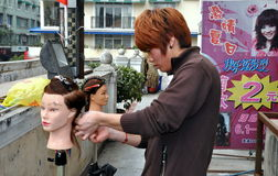 Pegzhou, China: Apprentice Hair Stylist at Work Royalty Free Stock Photos
