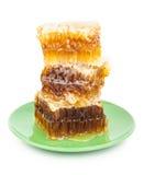 Peigne de miel d'un plat Photo stock