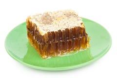 Peigne de miel d'un plat Photos stock