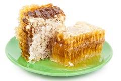 Peigne de miel d'un plat Images stock