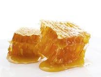 Peigne de miel sur le blanc Photo stock