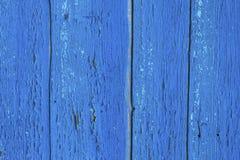 Peignez éplucher de vieux conseils en bois Images stock