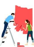 Peintre de couples sur le rouge Photos stock
