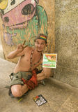 Peintre de doigt de Favela photographie stock
