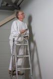 Peintre sur un travail photos stock