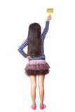 Peintres de petite fille avec des rouleaux de peinture Image libre de droits