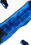 Peinture à l'huile bleue sur l'abrégé sur courses de brosse de toile photographie stock