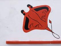 Peinture abstraite d'un manta rouge sur un conseil blanc image libre de droits