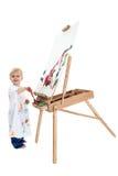 Peinture adorable de garçon d'enfant en bas âge au support Photo libre de droits