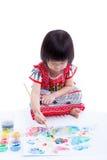 Peinture asiatique de fille et à l'aide des instruments de dessin, créativité Co Photographie stock libre de droits