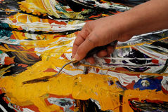 Peinture avec la spatule Photos stock