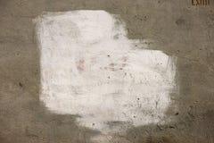 Peinture blanche sur le mur Photographie stock