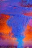 Peinture bleue abstraite sur le rouge Photos libres de droits