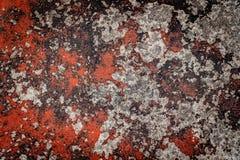 Peinture criquée rouge sur le vieux béton Photographie stock libre de droits