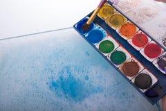 Peinture d'aquarelle se dissolvant dans l'eau Image libre de droits