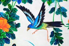 Peinture d'oiseau sur un mur Photographie stock