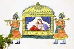 Peinture de chaise de berline sur le mur d'Udaipur image stock
