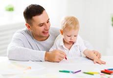 Peinture de fils de père et de bébé ensemble Photo libre de droits